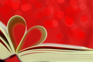 Selective focus image of book pages into a heart shape